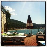 Photo taken at İnkum Terrace by Gülin D. on 9/12/2012