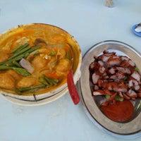Photo taken at Restoran Hai Ji 海记松鱼头 by Ck G. on 6/10/2012