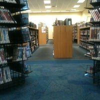 Photo taken at Orange County Library - Herndon Branch by Marcus S. on 7/17/2012