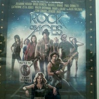 Photo taken at Cinemark Movies 8 by Ross V. on 7/21/2012