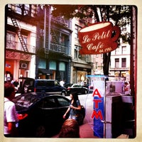 Photo taken at Le Petit Cafe by Kristofer P. on 5/26/2012