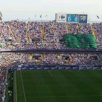 Photo taken at Estadio La Rosaleda by Victor M. on 5/13/2012