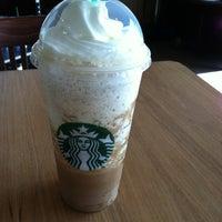 Photo taken at Starbucks by Emily W. on 6/6/2012
