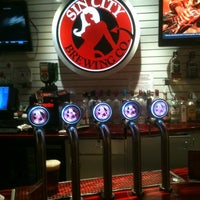 Photo taken at Sin City Brewing Co. by Jason L. on 3/15/2012