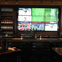 Photo taken at Jack Astor's Bar & Grill by Brett W. on 6/20/2012