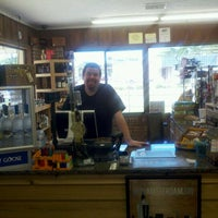 Photo taken at Top Shelf Spirits & Cigars by Daniel R. on 4/27/2012