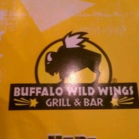 Photo taken at Buffalo Wild Wings by Gustavo C. on 5/8/2012