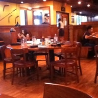 Photo taken at Outback Steakhouse by Sofia C. on 7/4/2012