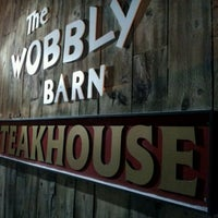 Photo taken at Wobbly Barn Steakhouse by J D. on 2/19/2012