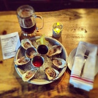 Photo taken at Upstate Craft Beer and Oyster Bar by Noah F. on 5/14/2012