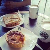 Photo taken at Starbucks by Jenny on 8/12/2012