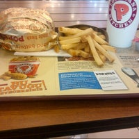 Photo taken at Popeye's by Erkunt T. on 8/4/2012
