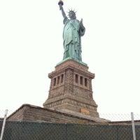 Photo taken at Liberty Island by Ravi M. on 3/25/2012