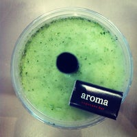 Photo taken at Aroma Espresso Bar by Nate K. on 7/8/2012