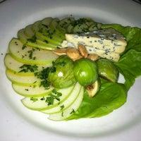 Photo taken at fatfish Wine Bar & Bistro by Brett B. on 9/2/2012