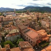 Photo taken at Torre Guinigi by Mike V. on 9/13/2012