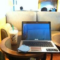 Photo taken at Starbucks by T Yu C. on 3/28/2012