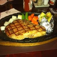 Photo taken at Chokchai Steakhouse by Surapas S. on 5/11/2012