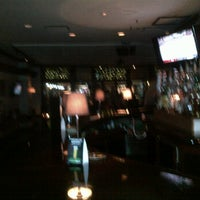 Photo taken at The Office Restaurant & Lounge by Mike L. on 2/26/2012