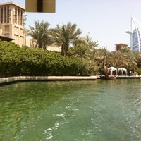 Photo taken at Madinat Jumeirah Private Beach by Christina L. on 8/12/2012