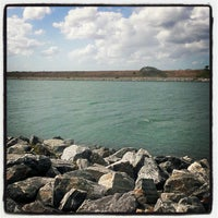 Photo taken at Jetty Park by Rob G. on 4/15/2012