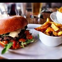 Photo taken at Domyno Burger Bar by Jan K. on 7/21/2012