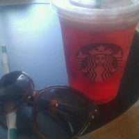 Photo taken at Starbucks by Emily E. on 5/21/2012