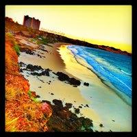 Photo taken at Praia de Cotovelo by Enzo A. on 2/4/2012