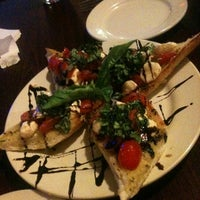 Photo taken at Sauced Sports Bar and Pizzeria by Lisa S. on 9/1/2012