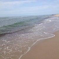 Photo taken at Nidos centrinis pliazas/ Nida Beach by Ieva on 8/1/2012