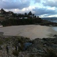 Photo taken at Praia de Fortiñón by Rubén A. on 3/17/2012