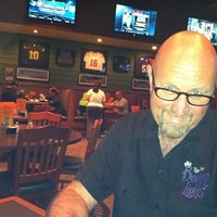 Photo taken at Houligan's by Christine Maentz S. on 3/8/2012