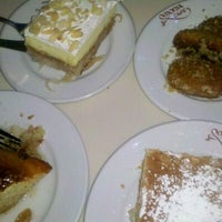 Photo taken at Omonia Cafe by Daisy L. on 2/13/2012