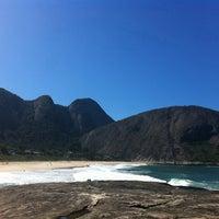 Photo taken at Praia de Itacoatiara by Mariana E. on 8/2/2012
