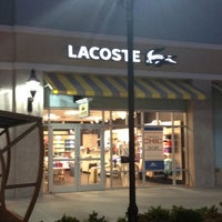Photo taken at Lacoste Outlet by Giselle M. on 7/25/2012