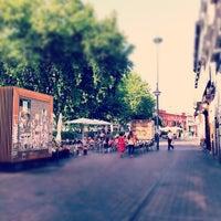 Photo taken at Plaza de Tirso de Molina by Ricardo G. on 8/8/2012