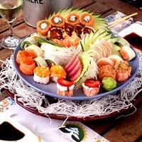 Photo taken at The Garden Sushi Bar by Ricardo A. on 3/21/2012
