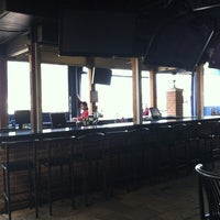Photo taken at Backyard Grill & Bar by Carrie L. on 2/22/2012