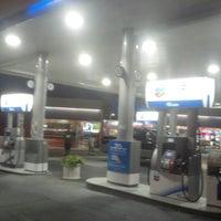 Photo taken at Chevron by Angela S. on 8/5/2012