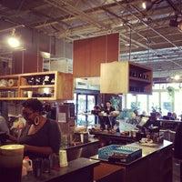 Photo taken at Bloc 11 Cafe by Dan N. on 3/31/2012