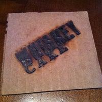 Photo taken at Whiskey Cake Kitchen & Bar by Gabby N. on 3/4/2012