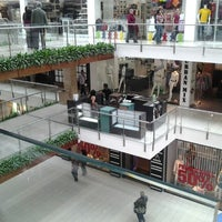 Photo taken at Quicentro Shopping by Milton R. on 9/1/2012