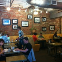 Photo taken at Ula Cafe by Paige on 4/28/2012