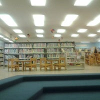 Photo taken at McCully-Mōʻiliʻili Public Library by Nikki G. on 5/8/2012