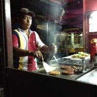 Photo taken at Burger Abg Basah Unikop by Pudin.Amir /. on 9/3/2012