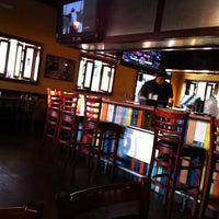 Photo taken at Merriman's Gourmet Pizza & Burgers by Adam D. on 3/31/2012