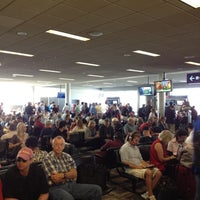 Photo taken at Gate G21 by Robert W. on 8/10/2012