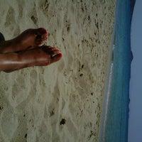 Photo taken at Plaka Beach by ELISA P. on 8/14/2012