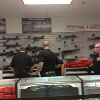 Photo taken at The Gun Store by Chiniqua on 8/5/2012
