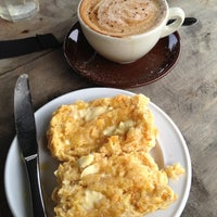 Photo taken at The Piha Cafe by Phillip K. on 3/24/2012
